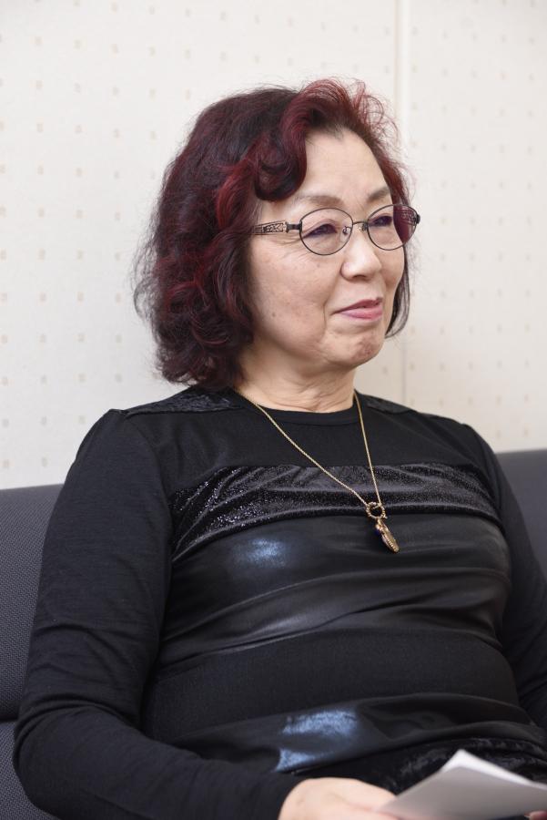 Sayoko Nobuta, speaking while smiling